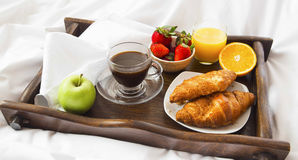 Bed breakfast. With croissants,fruits, coffee and juice Stock Image