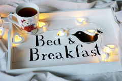 Bed & Breakfast, cup of tea. Cup of tea, bed and breakfast royalty free stock photo