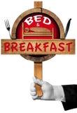Bed and breakfast - segno con la mano di un portiere Fotografie Stock Libere da Diritti