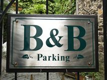 Bed and Breakfast sign. A bed and breakfast sign on a courtyard gate Royalty Free Stock Photo