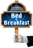 Bed and Breakfast - Sign with Hand of a Concierge Royalty Free Stock Photos