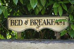 Bed and breakfast vintage sign. On fence. Devon, UK Stock Image