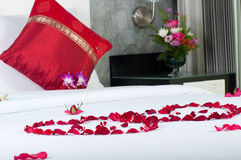 Bed for brides. Bedroom in a luxury hotel apartment made ready for brides on honeymoon Stock Images