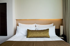 Bed in a business hotel room Royalty Free Stock Image