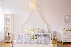 Bed with canopy and headboard Stock Photos
