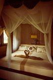 Bed with canopy Stock Images
