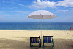 Bed canvas with bright umbrellas on the beach Royalty Free Stock Image