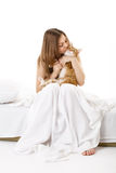 In bed with a cat Stock Photography