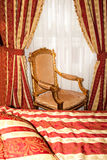 Bed and chair in the gold room Royalty Free Stock Images