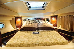 Bed in a Chaparral 310 cruise at Yacht Show 2012. Bed in a Chaparral 310 cruiser at Singapore Yacht Show 2012 at One degree 15 Marina Club, Sentosa Cove in Stock Images