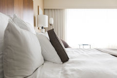 Bed. A clean bed in a modern bedroom Royalty Free Stock Image