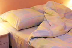 Bed clothes. Close up of bedding sheets and pillow on bed Royalty Free Stock Images