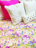 Bed with colorful floral design bedclothes Royalty Free Stock Image