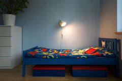 Bed with colorful sheet Stock Photography