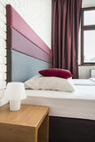 Bed with colourful headboard Stock Photos