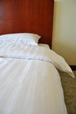 Bed and comforter. At hotel room Royalty Free Stock Images