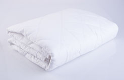 Bed comforter or bed cover on a background. Royalty Free Stock Photo