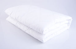 Bed comforter or bed cover on a background. Stock Photo
