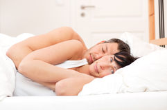 Bed couple Stock Images
