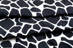 Bed cover in black and white leopard pattern.  Royalty Free Stock Photos