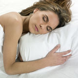In bed with a cute woman Stock Photography