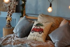 Bed decorated for Christmas with pillows and lights royalty free stock photo