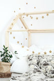Bed decorated with stars stock photos