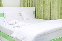 Bed with decorative towel - fold to be duck Stock Image