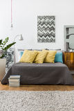 Bed with decorative yellow pillows Stock Photography