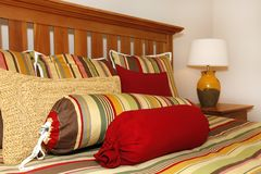 Bed details in red, yellow and green Stock Image
