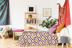 Bed in ethnic bedroom Royalty Free Stock Images