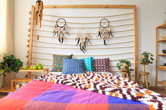 Bed with ethnic decorations Stock Image