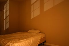 Bed in evening light. Bed and sheets in evening light Royalty Free Stock Images