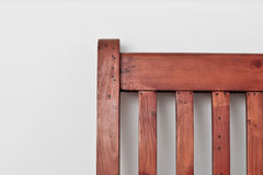 Bed frame. Corner of a wooden bed frame against a white wall Royalty Free Stock Image