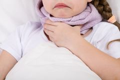 In the bed the girl has a sore throat wrapped in a scarf Stock Photography