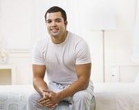 bed happy man sitting στοκ φωτογραφία