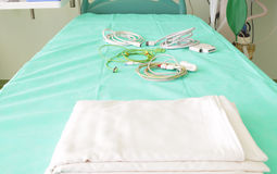 Bed in the hospital waiting for the patient. Royalty Free Stock Photography