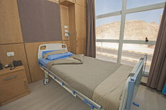 Bed in a hospital ward Stock Images