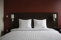 Bed in hotel Stock Photos