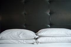 Bed in a hotel royalty free stock photo
