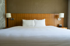 Bed in hotel. Stock Images