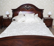 Bed in a hotel room Royalty Free Stock Images