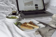 Business breakfast and laptop Stock Photography