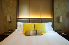 Bed in a hotel room Royalty Free Stock Image
