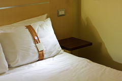 Bed in a hotel room at night Royalty Free Stock Photo