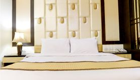 Bed in a hotel room at night Royalty Free Stock Photos