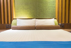 Bed in a hotel room at night, Thailand Stock Images