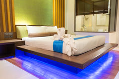 Bed in a hotel room at night, Thailand Royalty Free Stock Photo