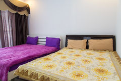 Bed in a hotel room , Thailand Royalty Free Stock Image