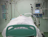 Bed ICU with the patient. Patient in the intensive care unit is connected to the apparatus Royalty Free Stock Photo